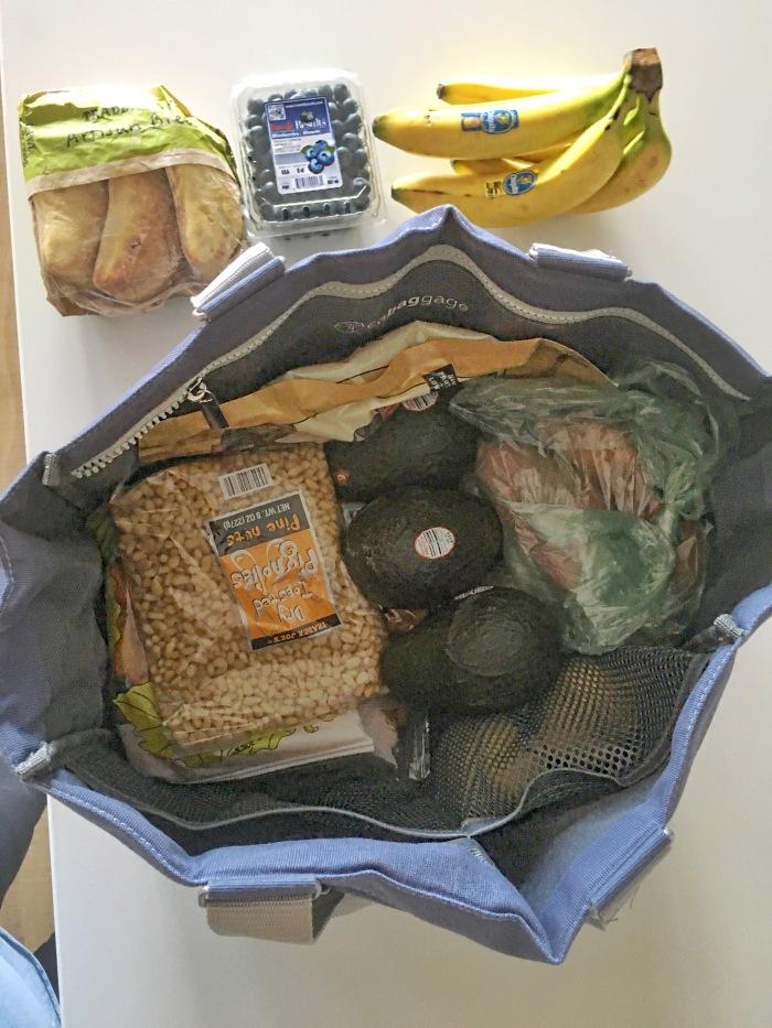 almondsandasana_cabbagage bag with food