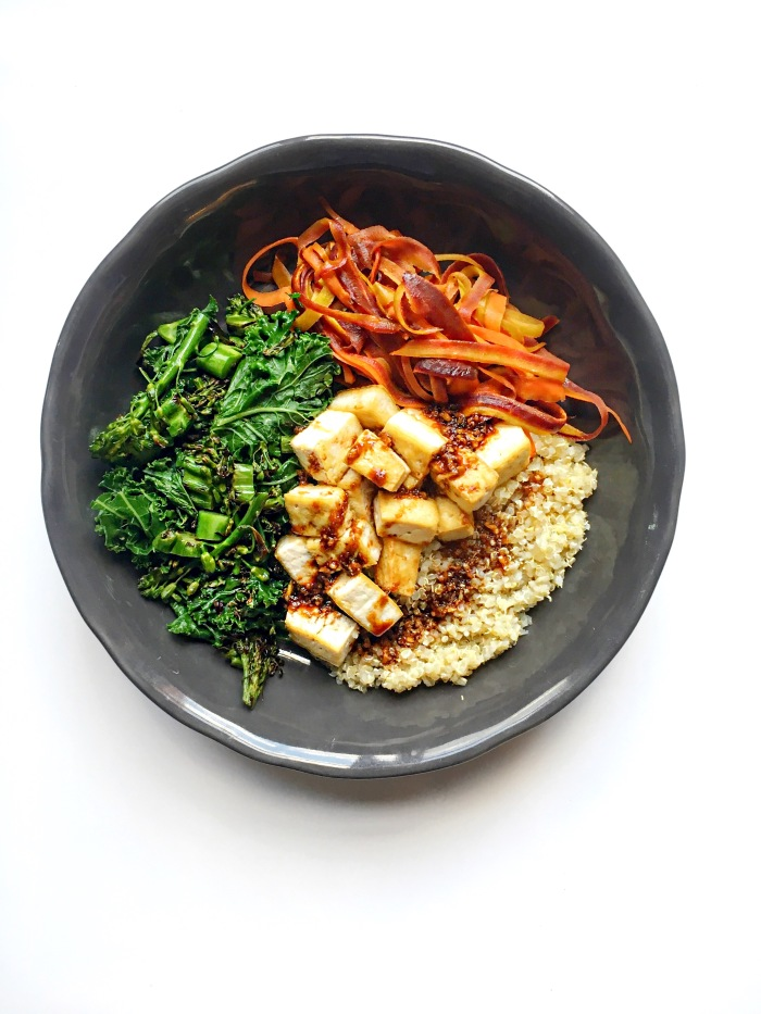 almonds and asana asian quinoa tofu bowl with ginger garlic soy sauce
